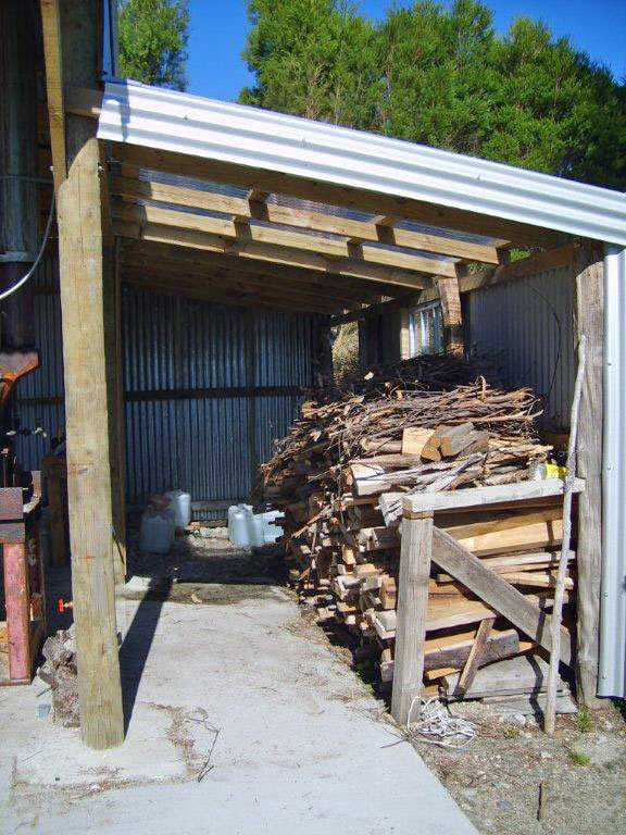 Wood stacked inside a woodshed next to bolier room